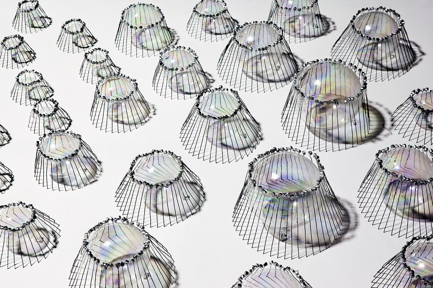 Jelly Fish, 2013, bottle corks, wire, glass balls, car paint on canvas