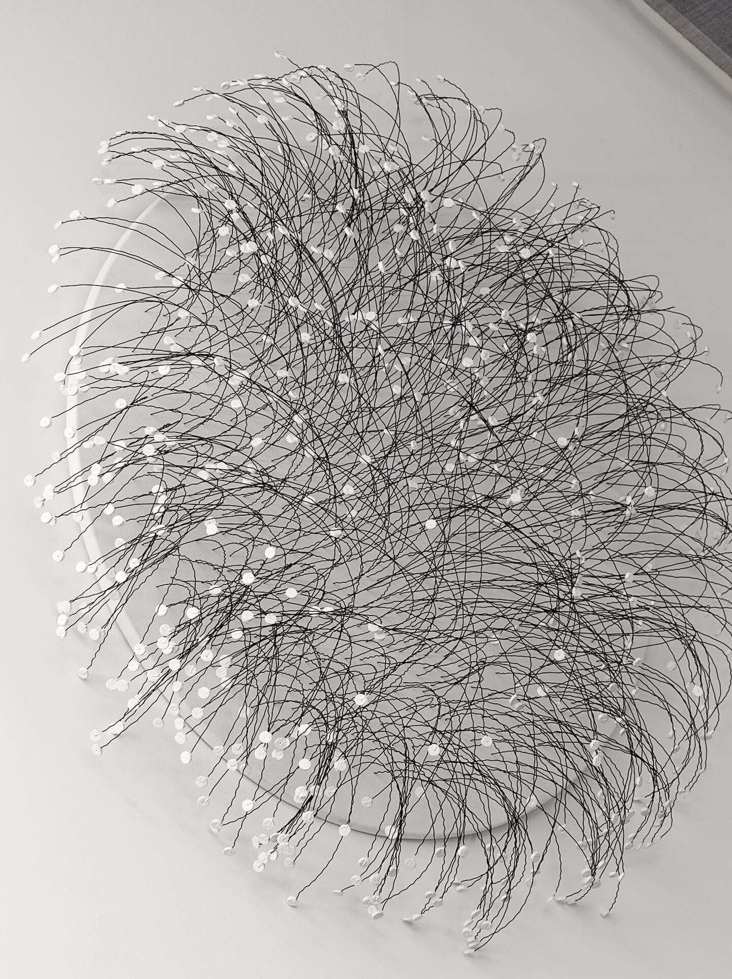 Renate Fabricius, Life, 2016, bottle corks, wire, acrylic paint on canvas, Diameter 70cm